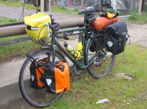 Loaded bike with raincover on the handlebar bag